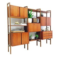 Mid century 3 bay wall unit. Overall in good condition with minor scuffing/scratching (see photos and zoom in for more details). This pieces contains a bar (wit