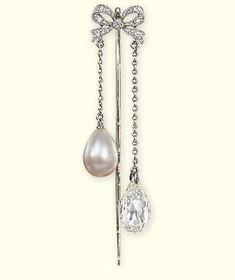 A BELLE EPOQUE PEARL AND DIAMOND PIN BROOCH   The small single-cut diamond bow suspending a drop-shaped pearl and a briolette-cut diamond, pearl untested, circa 1905, pin 5.6 cm long