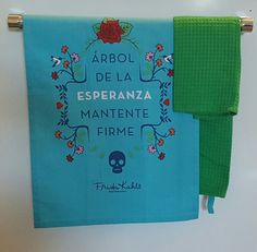 Frida Kahlo Kitchen Tea Towels  Brand - Frida Kahlo  Color - Blue, Green, Navy, Orange, & Red  Condition - New with tags  Details - Super cute & modern towels with Fridas words Arbol de la esperanza mantente firme (Tree of hope stay firm) printed on the blue towel surrounded by vines, flowers, hearts, hummingbirds, & a skull at the bottom. The green towel is a great & simple accent to the printed blue towel. Both towels feature a tab to in order to hang from a hook. Material -...