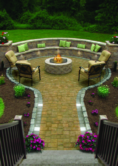 The Round Table Collection in Sahara/Chestnut with Wall/Tread Lights and #Paver #Lights #outdoorliving #patio #firepit #backyard #pavingstones #cambridgepavers #cambridgepavingstones #armortec