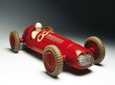 """In Germany, we had a word for this kind of toy racing car, Kneterenner, which means 'putty racer'. You'd fill your racing car with putty for weight and then push it down the sidewalk. The car that went the farthest won. Mercury sold a catapult for these kinds of races in a set with one or two racing cars. Can you imagine how the cars looked after those races? They were not mint anymore, that's for sure!"""