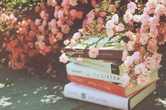 books breathe in blossoms  they were carefully lain here  on the chilled cement