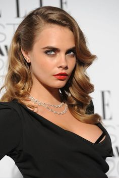Cara Delevingne brings a touch of old Hollywood glamour in plunging gown to the…