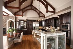 Rustic beams and high ceilings in this kitchen.  Ranch House Plan # 221271.