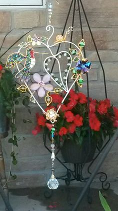 Wire wrapped beaded sun catcher with flowers and hummingbird. Snail and nest.