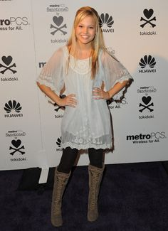 Olivia Holt's lacy top and boots make for a fab back-to-school look.