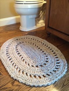I could never find a small, cute rug to fit our little bathroom so I made one! This is a pattern from Ravelry.com, and I followed the pattern but used 2 strands held together of Lion Brand Wool-Ease Thick and Quick yarn and a size P crochet hook.