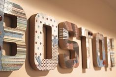 modpodged cardboard letters: I need an L and an S for my living room wall. I want to paste on family pics...