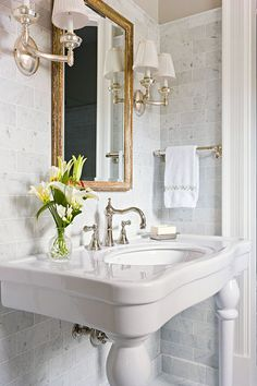 Elegant bath by Ellen Conley. Antique mirror and sconces from the Brighton Classic Collection. Via TraditionalHome.com