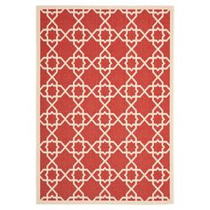 Anchor your patio seating group of add classic appeal to the foyer with this versatile rug, showcasing a timeless trellis motif in red.