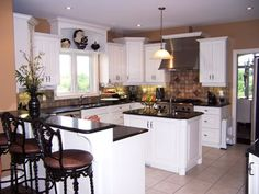 kitchen ideas for brown walls, black appliances and white cabinets - Bing Images