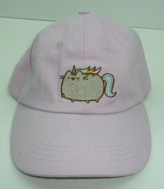 38fc4c80cfba6 A very cute pink hat that features Pusheen as a fat cat unicorn. Great for  any Pusheen fan!