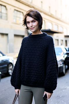 love her sweater and her haircut