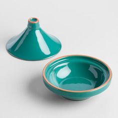 Crafted of terracotta in navy and teal, our exclusive tagines are the ideal size for slow cooking appetizers and serving right at the table. They're also chic serving vessels for salads, sauces and other foods.