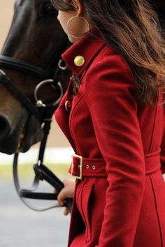 Gold hoops and bright red coat. (The horse is a nice bonus though...)
