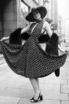 Marion Cameron in a Christian Dior dress and hat   - HarpersBAZAAR.com