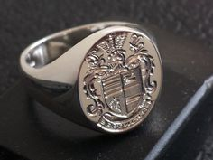 Hand made and engraved with your family coat of arms or crest, available in extra large sizes a solid ring throughout and fully hallmarked. contemporary matt finish or classic high polished finish. Unique Diamond Engagement Rings, Shop Engagement Rings, Family Crest Rings, Signet Ring, Hand Engraving, Coat Of Arms, Fine Jewelry, Jewellery, Rings For Men