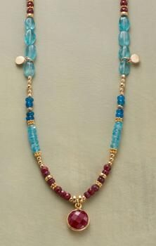 Our handmade ruby and apatite necklace exudes a vivacious sense of charm.