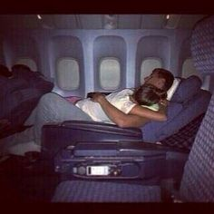 "this will be us on long flights.. ""babe this flight is so freaking long im ready to strangle someone"" ""shhh come here"" .. :) -L"
