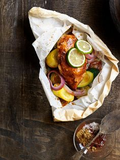 Baking chicken in packets helps retain the moisture and flavor of fresh zucchini, squash, and onions.