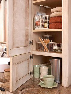 counter top cabinet in the bathroom with power in the back. Perfect for hiding hot tools.