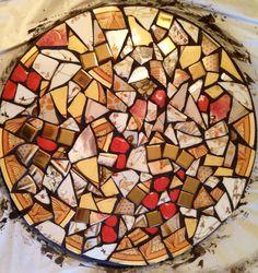 DIY mosaic garden stone made of broken antique plates