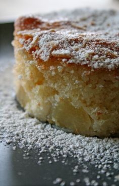 Soft Pear Cake ~ Ingredients:   4 pears, peeled, cored and cut into ¼ inch slices 180g sugar 4 whole eggs 150g flour 125g butter, melted and cooled a pinch of salt 2 tsp baking powder 2 Tbsp sultana raisins 2 Tbsp almond slivers