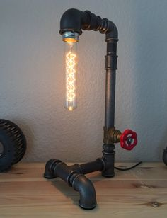Steampunk iron pipe lamp with Edison tube bulb by Alles im Griff.