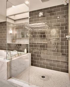 like the brown subway tiles and white river rocks