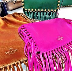 Valentino fringe leather: magenta clutch, fulvous drawstring bag, emerald courier, &c.