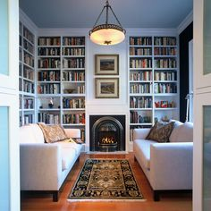 sitting room/library, white furniture, floor to ceiling bookshelves