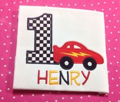 Personalized Birthday Race car and number applique is machine embroidered directly onto super soft and thick white shirt or bodysuit.  Number is appliqued using black and white checkered fabric.  Race