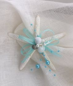 Beautiful 5 inch white starfish embellished with white and aqua ribbon, shells, and faux pearls. Would be lovely on coastal tree or just as a beachy decoration. Seashell Christmas Ornaments, Coastal Christmas Decor, Nautical Christmas, Seashell Ornaments, Christmas Crafts, Christmas Wood, Etsy Christmas, Christmas Decorations, Sea Crafts