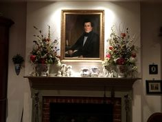 19th century oil portrait over mantle with Staffordshire dogs and posset pots.