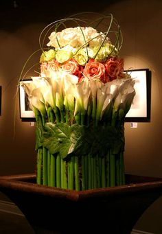 architectural design but widly cool floral centerpiecescenterpiece ideasfloral