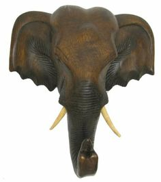 Exotic Hand Carved Wooden Elephant Head Wall Decor Art Dark Mocha Medium by Hand Carved Art by Yaki Yak. $32.99. Accent your decor with this beautiful hand carved wooden elephant head wall decor. Please note this is real wood, not resin. It is intricately carved by skilled artisans in Northern Thailand. By buying this product, you will be supporting the local artisans economically as well as preserving the traditional hand carved artwork.. Save 13% Off!