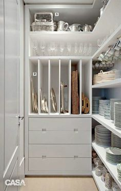 We love the use of tray dividers for storing platters and serving dishes in a pantry area. | apartmenttherapy.com