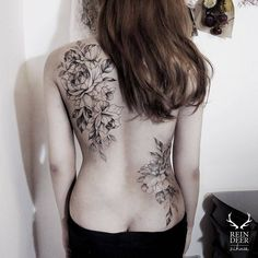 Flower bouquet tattoos on the back. Done at Reindeer Tattoo Studio