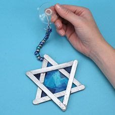 Simple Star of David sun catcher craft (would make a sweet Christmas tree ornament to combine the traditions of Hanukkah and Christian holidays)