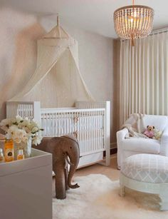 Sparkly Ivory Baldachin Over White Clical Crib Near Large Elephant Toy Made From