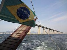 From Guanabara Bay with view to Rio-Niteroi bridge Learn Brazilian Portuguese, Sailing, Bridge, Learning, Places, Outdoor Decor, Rio De Janeiro, Candle, Lugares