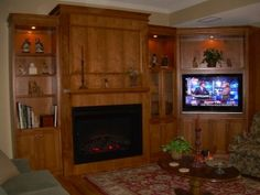 This complete corner wall unit comes with an electric fireplace on the main wall. The custom-fit TV opening is at a 45 degree angle in the corner. This can be built around a gas fireplace. Classic Fireplace, Custom Fireplace, Gas Fireplace, Fireplaces, Electric Fireplace, Tv Built In, Built Ins, Corner Tv, Corner Wall