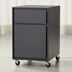 Shop Pilsen Graphite Two Drawer File Cabinet.   Designed by Mark Daniel, the cabinet has a low profile making it ideal for any home office.   The Pilsen Two-Drawer File Cabinet is a Crate and Barrel exclusive.