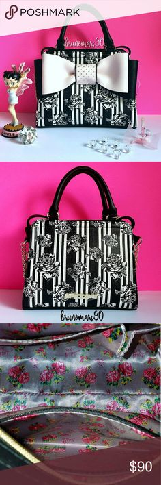 "✨HP✨ Large Bow Satchel Bag NWT A girly delight, a bag that is convenient to use as well as wonderful to look at! Features black and white stripes with black and white roses and black sides, signature logo plates, double top handles, detachable chain detail crossbody strap, top zip closure, a zipper interior pocket, and two interior open pockets. Measures approx. 9""H x 11.5""W x 5""D. Comes with an Ellen Tracy cosmetic bag with zip closure. HOST PICK Style Crush Party 7.13.17 ✨ Best In Bags…"