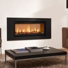 DRU Global gas fires offer all the benefits of a quality DRU fires, but at a prices that are affordable for the average household. Wall Gas Fires, Electric Fires, Living Room, Building, Ski Chalet, Sally, Design, Home Decor