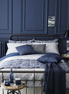 Lots of layered patterns in blue. Idea for our blue guest bedroom