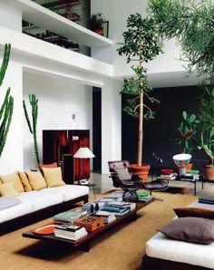 Zo cool: een woonkamer met metershoge cactussen op trolleys - Roomed