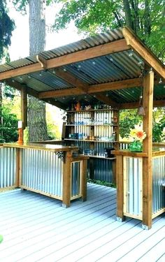 Outdoor Kitchen Ideas on a Budget (Affordable, Small, and DIY Outdoor Kitchen Ideas) #diy #howtobuild #backyards #patio #smallspaces #simple #rustic #savingmoney #countertops #fireplaces #decks #porches #curbappeal #sinks #laundryrooms