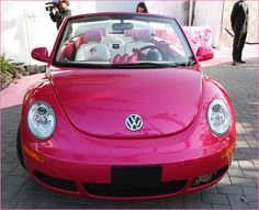 a hot pink Barbie VW Bug convertible??? :D
