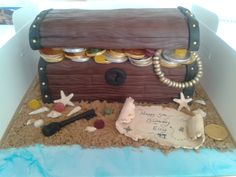 pirate treasure chest -  Chocolate sponge with chocolate buttercream, covered in chocolate fondant - my kitchen smelt like a chocolate factory! Filled with shop-bought sweets, hand crafted fondant key and map, shells made from fondant pressed into a mould. Sand soft brown sugar. I was a bit nervous as I'm not very experienced, but my friend was very happy with the result..thank goodness!